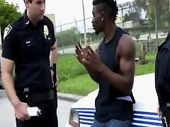 Muscular black stud with a huge cock fucking female cops hard!