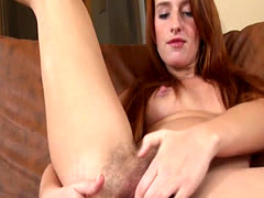 Hairy redhead plays with herself