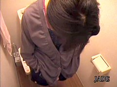 Cute Japanese girl nude masturbation in the toilet