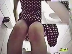 A naughty Asian masturbates in toilet cabin