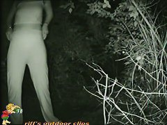 A sexy teen hides in the bushes while pissing voyeur cam