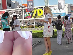 Sexy blonde in white dress lures up skirt camera