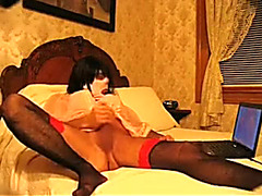 Bawdy and freaky crossdresser in the mask masturbating on web camera