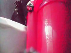 Close distance toilet spy cam of a woman pissing