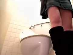 Lusty Japanese hoe fucked a massive dildo in a toilet