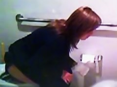 Fresh Asian girls peeing in the school toilet