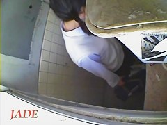 A horny Asian chick masturbating in the college toilet