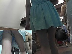 Sexy girl in a-line blue dress presents upskirt goodies