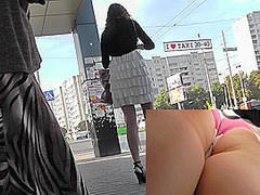 Pretty upskirt panties covering her hot buttocks