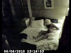 Milf staying on knees on her bed and masturbating beaver